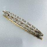 Geel en wit gouden broche bezet met 0.35 ct diamant_