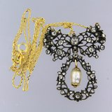 Gold necklace with gold with silver centerpiece set with 0.80 ct diamond_