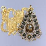 Gouden collier met goud met zilver hanger bezet met 0.30 ct diamant_