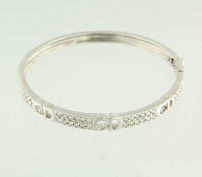 Witgouden scharnier armband met 1.00 ct diamant
