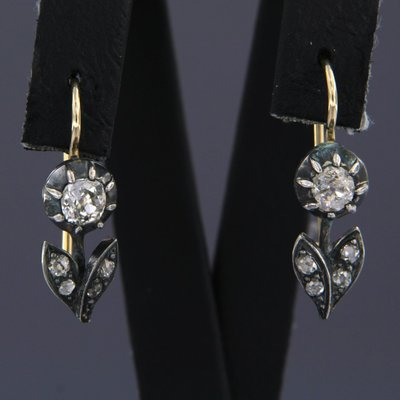 Gold with silver earrings with 1.10 ct diamond