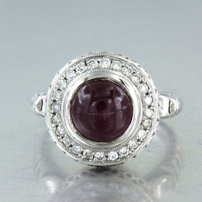 White gold ring with ruby and 0.36 ct diamond