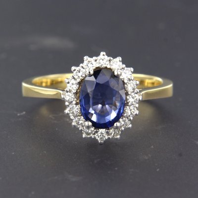 Bicolour gold ring with sapphire and 0.34 ct diamond