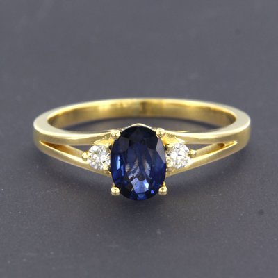 Golden ring with sapphire and 0.12 ct diamond