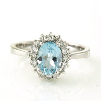 Witgouden ring met topaas en 0.26 ct diamant