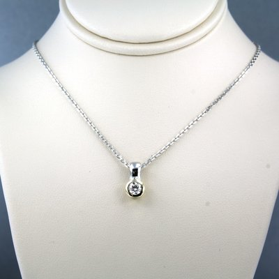 White gold necklace with bicolour pendant with 0.26 ct diamond