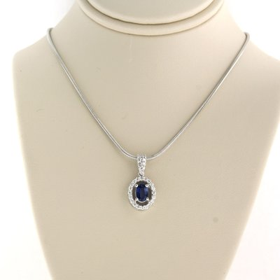 White gold necklace with sapphire and 0.23 ct diamond