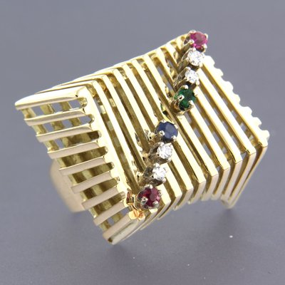 Gold ring with emerald, ruby, sapphire and 0.18 ct diamond