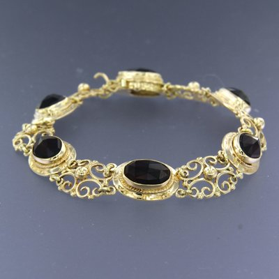 Golden bracelet with garnet