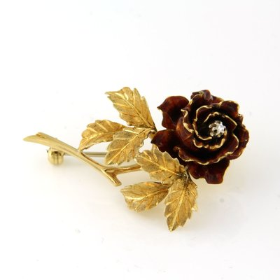 Gouden bloem broche met 0.02 ct diamant