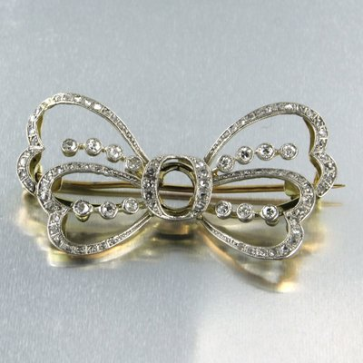 Gold with platinum brooch set with 0.72 ct diamond