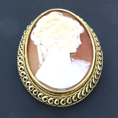 Golden cameo brooch and pendant with portrait of a lady