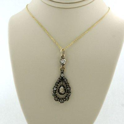 Gouden collier met goud met zilver hanger bezet met 0.80 ct diamant