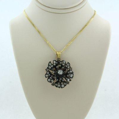 Gouden collier met goud met zilver hanger bezet met 1.50 ct diamant