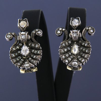 Gold with silver earrings set with 1.00 ct diamond
