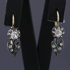 Goud met zilver oorbellen met 1.10 ct diamant