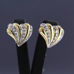 Bicolour gouden oorbellen met 1.00 ct diamant