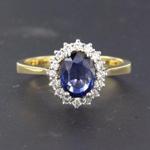 Bicolour gouden ring met saffier en 0.34 ct diamant
