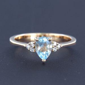 Roségouden ring met topaas en 0.12 ct diamant