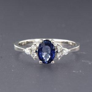 Witgouden ring met saffier en 0.16 ct diamant