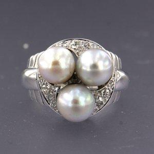 Witgouden ring met parel en 0.23 ct diamant