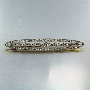 Geel en wit gouden broche bezet met 0.35 ct diamant
