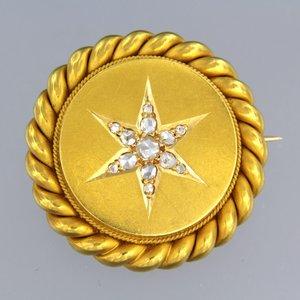 Gouden broche bezet met 0.15 ct diamant