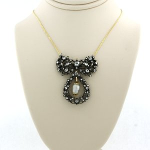 Gold necklace with gold with silver centerpiece set with 0.80 ct diamond
